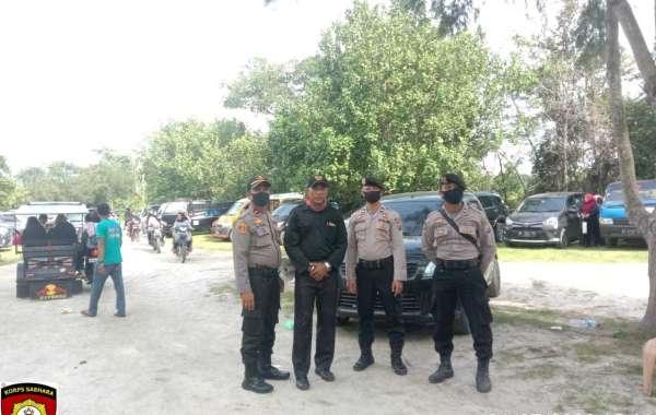Kapolsek Indrapura AKP Sandi. S,H. Ajak Pengunjung Objek Wisata, Tetap Ikuti Protokol Kesehatan dan Displin
