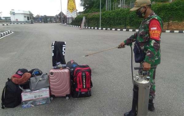 Tegakkan Protokol Kesehatan,TNI Perketat Pengawasan PMI Di Entikong